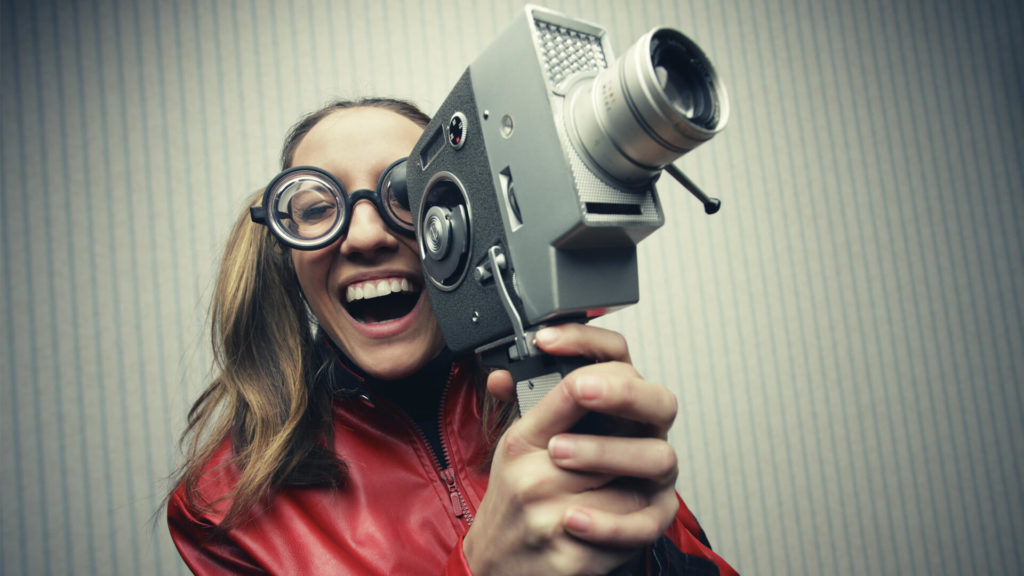 woman holding old video camera